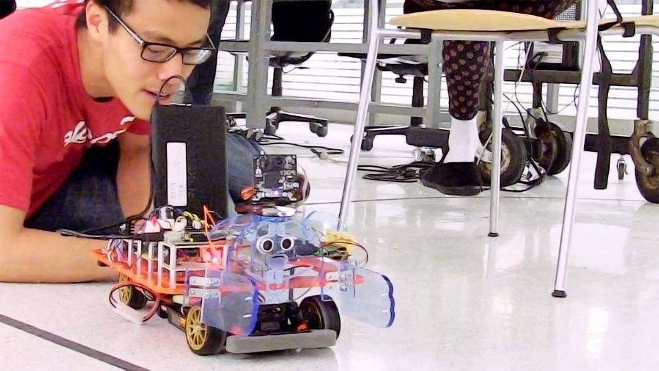 Robot car with googly eyes