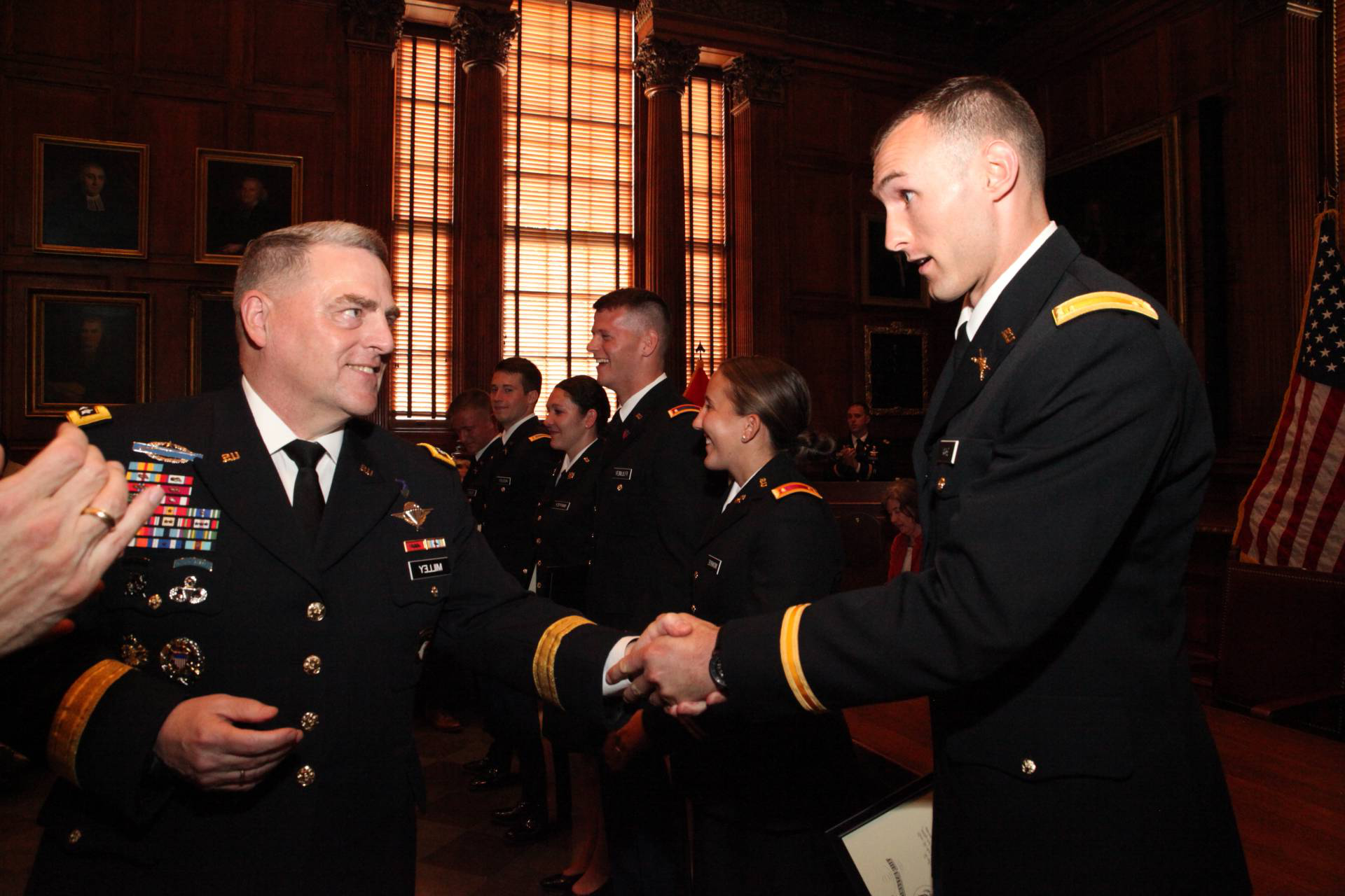 Mark Miley congratulates a student of ROTC